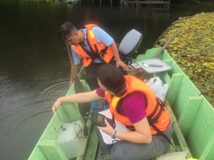 Edris and Jenna collecting water quality data in Tungong Lake
