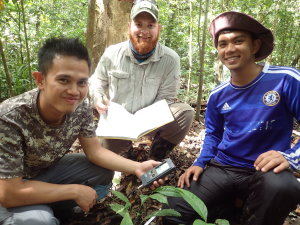From left to right: Faijan, Phil and Amir using the soil pH and temperature meter OLYMPUS DIGITAL CAMERA
